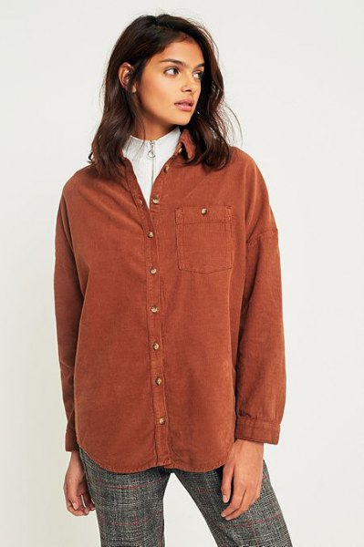 brown shirt over white mock neck sweater