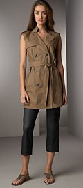 brown sleeveless tunic with belt and black, cropped trousers