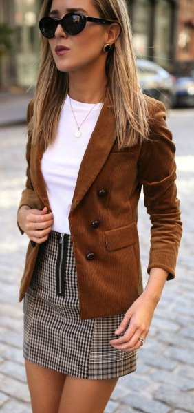 brown suede blazer with white top and checked mini skirt