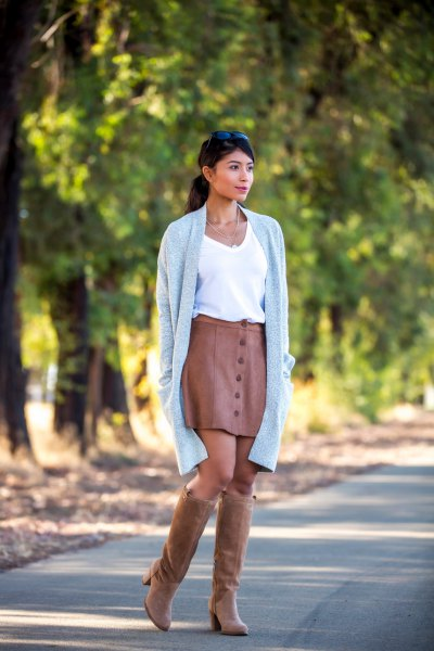 brown suede knee high boots with matching leather skirt