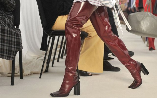 brown, thigh-high, shiny, square toe boots made of leather with a striped shirt dress