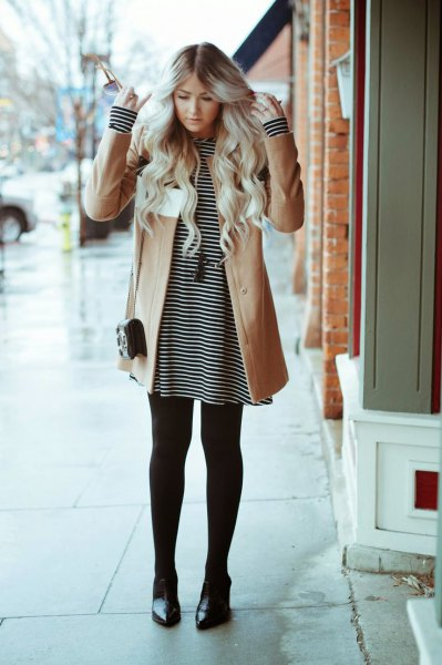 striped t-shirt with a brown wool coat