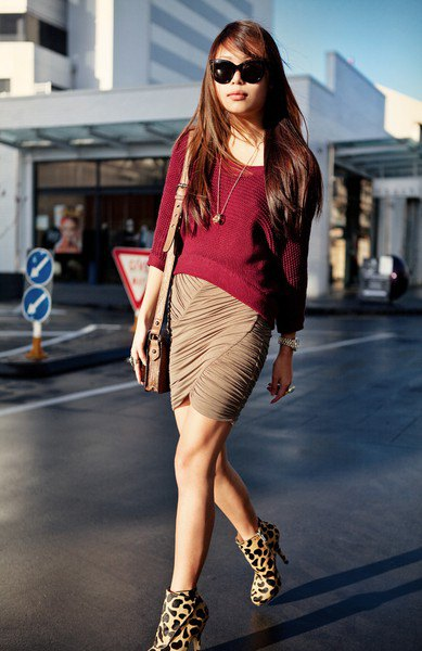 burgundy-colored sweater with boat neckline and leopard print
