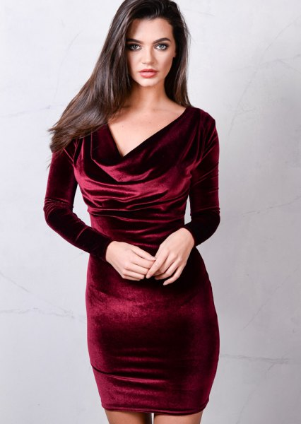 Burgundy, figure-hugging velvet dress with a waterfall neckline
