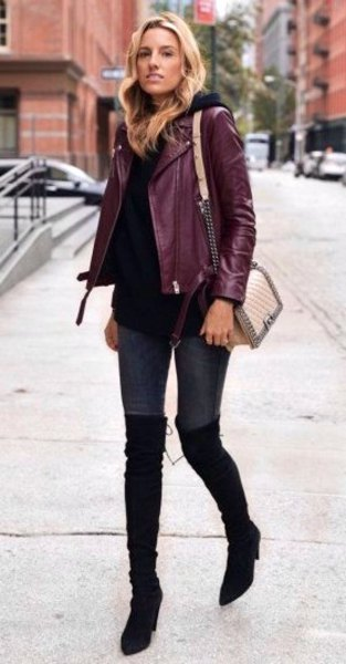 Burgundy jacket with black sweater and overknee boots