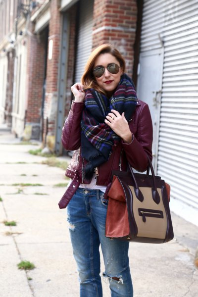 Burgundy leather jacket with black and blue checked scarf