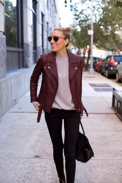 Burgundy leather jacket with gray t-shirt and black skinny jeans