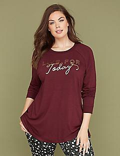 burgundy long sleeved graphic t-shirt with black and white polka dot trousers