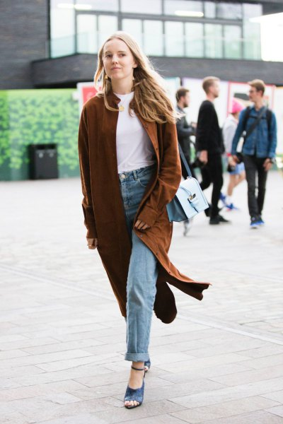 Burgundy longline cardigan with a white t-shirt with a round neckline and jeans with cuffs