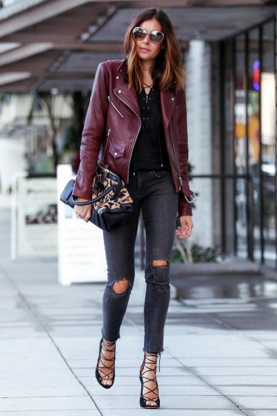 Burgundy oversized leather riding jacket with gray skinny jeans
