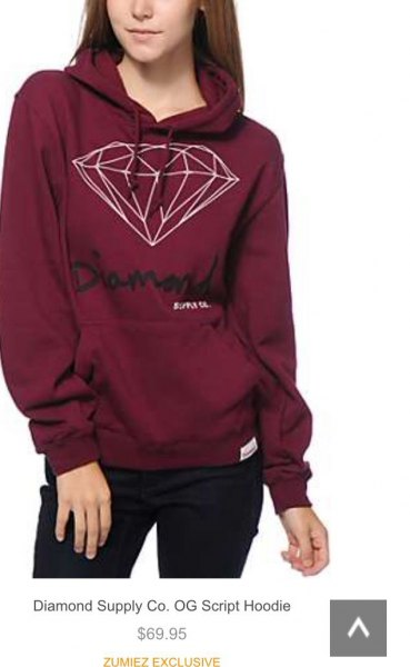 burgundy printed sweater with black skinny jeans