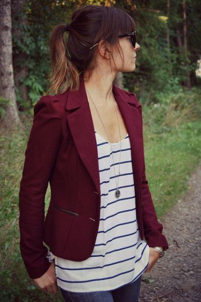 Burgundy red short blazer with a black and white vest top with a scoop neckline