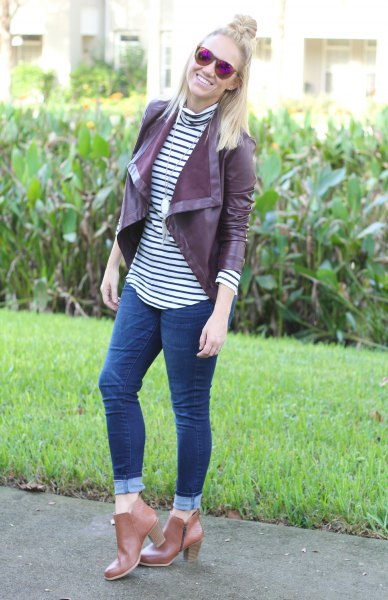 Burgundy short leather blazer jacket with black and white striped T-shirt with stand-up collar