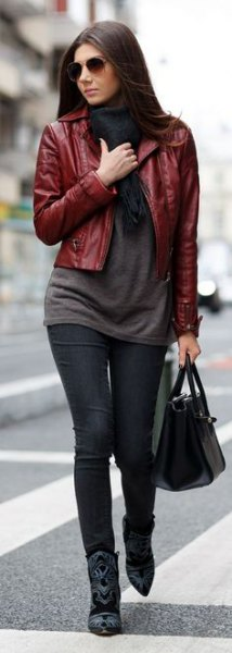 Burgundy short leather jacket with gray long sweater and black jeans