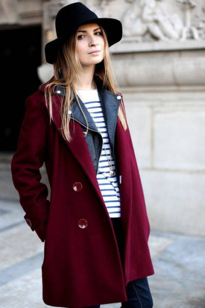 Burgundy trench coat with a black and white striped sweater and felt hat