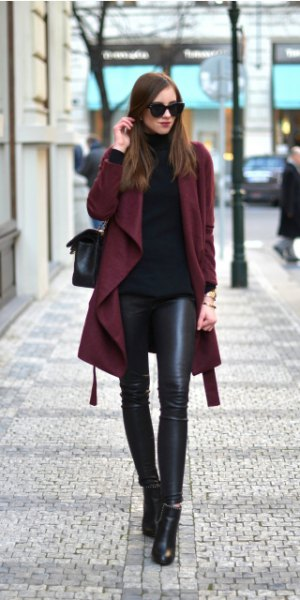 Burgundy trench coat with black turtleneck and leather gaiters