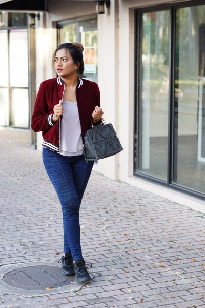 Burgundy velvet blazer with a gray t-shirt with a scoop neckline and blue slim fit jeans