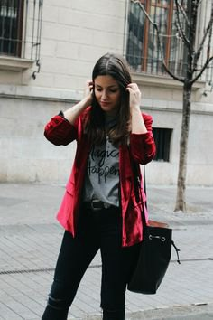 Burgundy velvet jacket with gray graphic t-shirt and black jeans