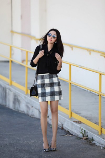 Blouse with button closure and black checked mini skirt