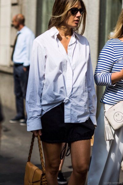 knotted shirt with buttons and black mini skirt