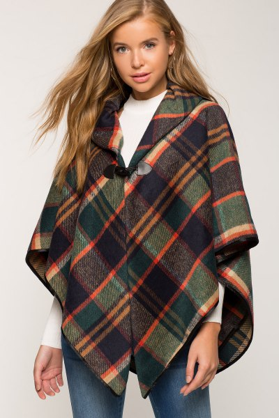 buttoned gray and orange plaid poncho white sweater with round neck