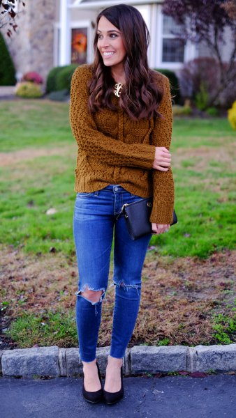 Cable knit sweater with royal blue skinny jeans