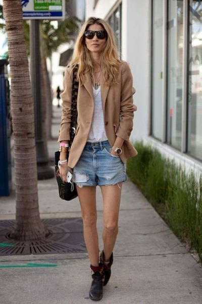Camel blazer jacket with a white V-neck top and jean shorts
