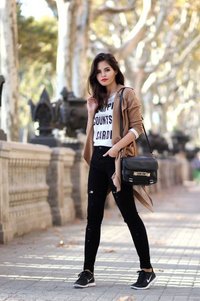 Camel blazer with black high-rise jeans and tennis shoes