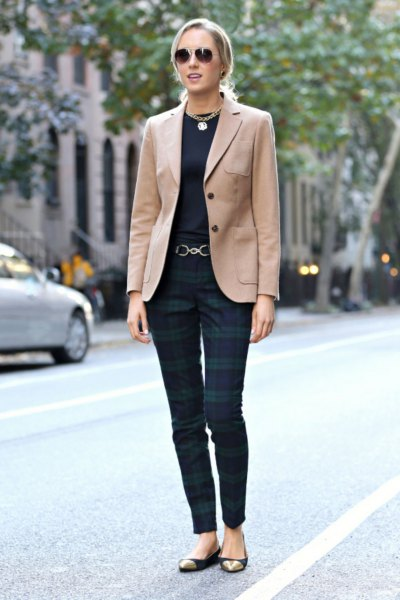 Camel blazer with black t-shirt and dark gray checked pants