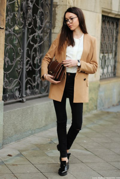 Camel double-breasted blazer with a white blouse and black skinny jeans