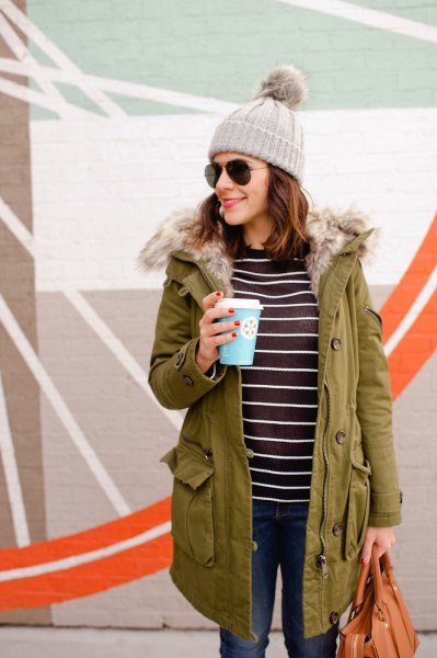 Camel-lined parka coat with a black and white striped T-shirt