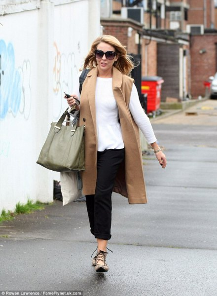 Camel long coat with a white long sleeve t-shirt
