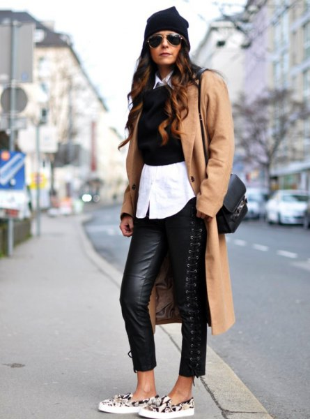 Camel longline wool coat with black leather gaiters and canvas shoes with animal motif