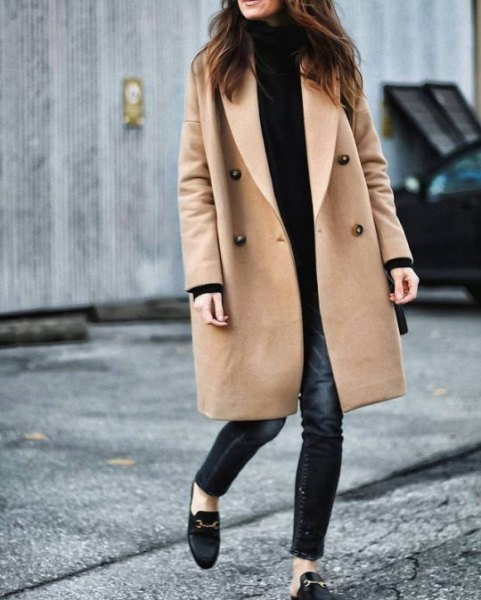 Camel longline wool coat with black mock neck sweater and maxed skinny jeans
