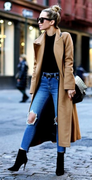 Camel taxi wool coat with black top and ripped blue jeans