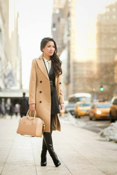 Camel midi length double-breasted wool coat with leather thigh boots