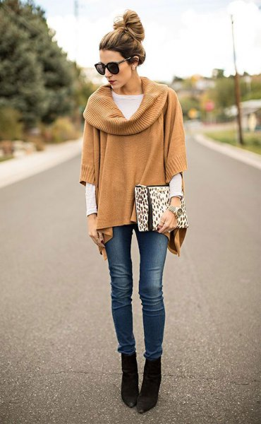 Camel ribbed poncho sweater with sleeves and black pointed ankle boots