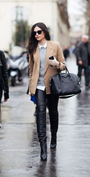 Camel short blazer coat with gray sweater and leather gaiters