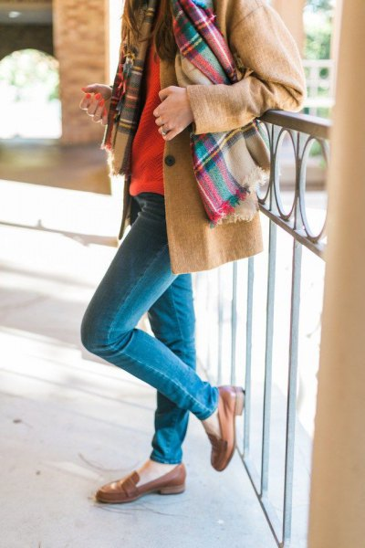 Camel wool coat with a checked scarf and brown slippers