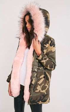Hooded fur-lined parka jacket with white blouse