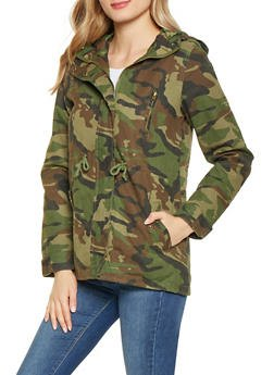 Camo windbreaker with gray-blue skinny jeans