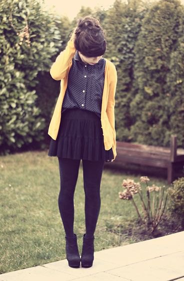 Cardigan with black polka dot shirt with mini pleated skirt