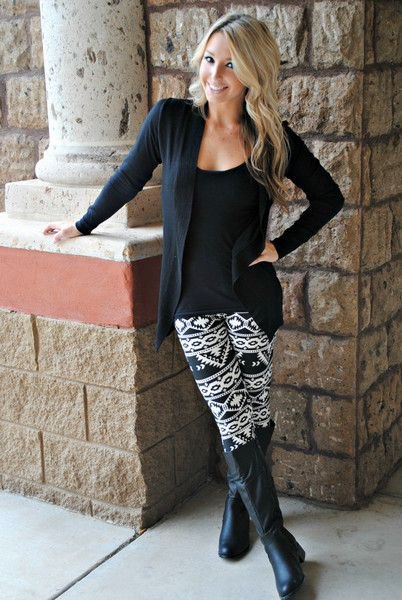 Cardigan with a scoop neck T-shirt and black and white leggings with a tribal pattern