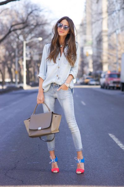 Chambray shirt with buttons and light blue skinny jeans with cuffs