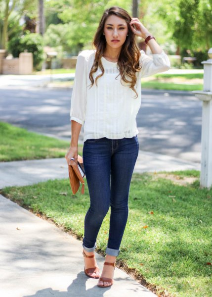 Skinny jeans with a chiffon blouse and cuff