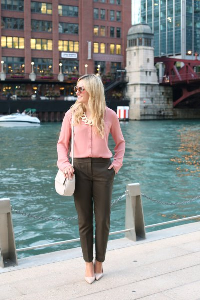 Chiffon shirt with button placket with statement chain and gray chinos