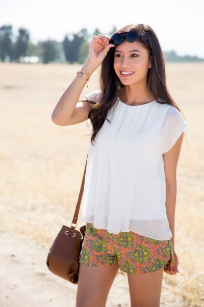 short white top made of chiffon orange with a floral pattern