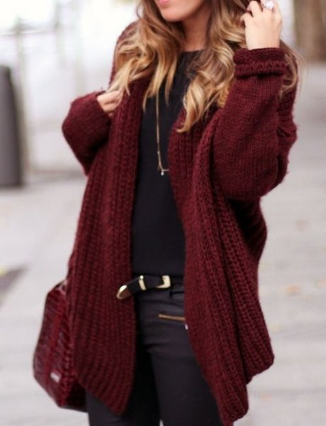 chunky maroon cardigan with black t-shirt and leather moto pants