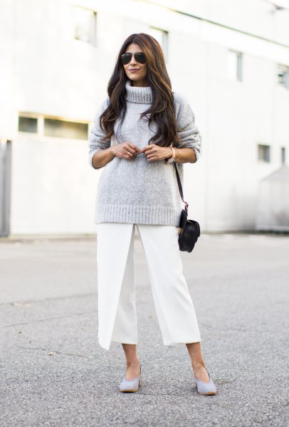 gray knitted sweater with turtleneck and white, cropped pants with wide legs