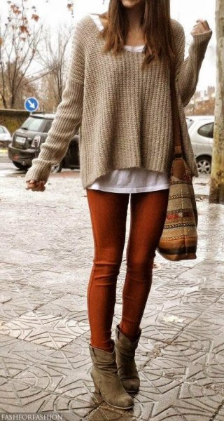 Coffee brown, slightly flared knitted sweater over a white tank top